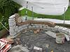 Muret de jardin décoratif, élaboré en blocs silico-calcaires