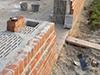 Muret de soubassement et parement-de briques pleines