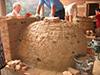 Fabrication d'un Four à pain, briques pleines maçonnées à la Chaux