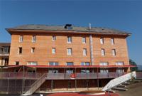 Isolation d'un Complexe scolaire en Chaux/chanvre, la finition est laissée brute