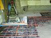 Chauffage en tubes hydrauliques pour dalle à la Chaux, isolée en panneaux de liège