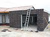 Isolation extérieure en panneaux de liège, pour un garage