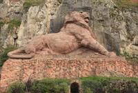 Participation à la restauration du monument historique célèbre, le Lion de Belfort au pied de la Citadelle